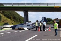 P-51 crash lands on a freeway.