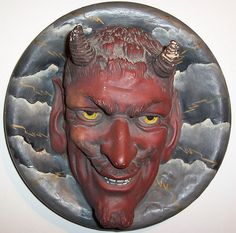 Vintage painted clay Devil wall hanger