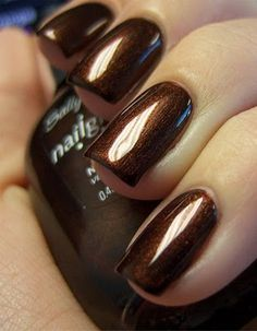 Sally Hansen Nailgrowth Miracle polish in Forbidden Fudge - I LOVE this name and the color is a gorgeous shimmery, rich, deep, candy brown. I just purchased it today from CVS and can't wait to wear it. Paired with a pastel mint-colored nail polish, one can create a pretty look inspired by Andes chocolate mints candies. :)