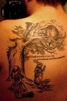 Alice in Wonderland back tattoo- LOVE