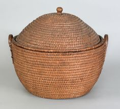 "Realized Price: $ 8888   Massive Pennsylvania lidded rye straw hamper basket, 19th c., with a turned wood finial and bentwood handles, 23"" h., 27 1/2"" w"