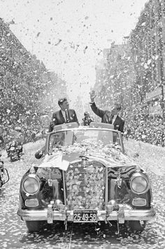 U.S. President John F. Kennedy and Mexican President Adolfo Lopez Mateos are showered with tons of confetti and paper, June 29, 1962, as they travel down one of Mexico City's boulevards shortly after Kennedy's arrival for a three-day visit.