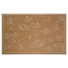 Handmade indoor/outdoor floor mat with a seashells motif.   $28