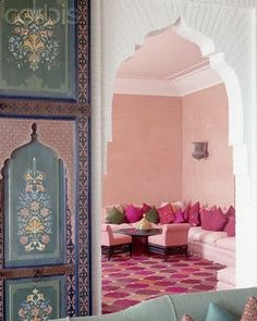 Beautiful pink salon and blue painted doors in Morocco.