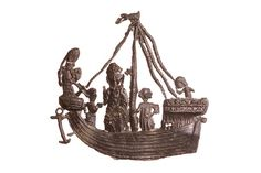 Late 14th century pilgrim's badge. This badge depicts the return of St Thomas Becket from exile in France in December 1170, only a month before his murder. This anniversary was commemorated every year at Canterbury with a festival known as the Return of St Thomas (Regressio Sancti Thomae). Here he is shown on board the ship with three companions: a knight, a clerk holding a book, and a third standing next to St Thomas.     Museum of London.