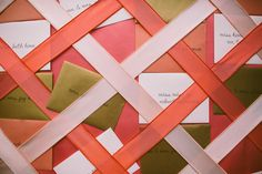 escort card envelopes behind ribbon // photo by Caroline Ghetes, styling by Events of Distinction // http://ruffledblog.com/colorful-sonoma-valley-wedding
