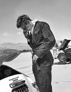 James Dean checks his car before a race in Palm Springs, March 1955.