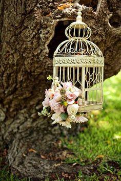 Garden bird cage with flowers