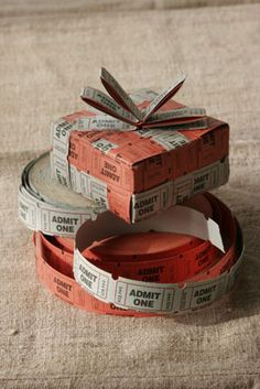 Use tickets to wrap & ribbon a package.  This would be a great way to wrap a gift that had tickets to an event inside the box.