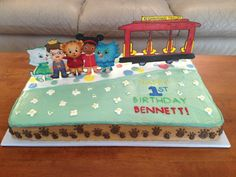 Daniel Tigers Neighborhood cake with gum paste characters and Trolley