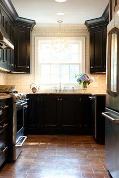 small kitchen designs, window, floor, small kitchens, black cabinets