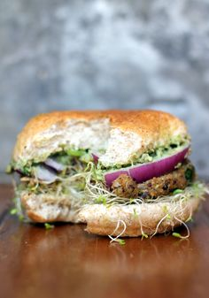 Spicy Sweet Potato Black Bean Burgers with avocado cilantro crema + sprouts #healthy #crave