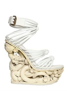 I am very scared of this #shoeoftheday in more ways than one. EMILIO PUCCI - 150MM DRAGON RESIN AND CALFSKIN WEDGES - LUISAVIAROMA