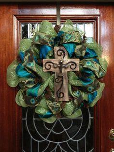 Peacock Cross Deco Mesh Wreath. $85.00, via Etsy.