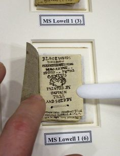 The actual size, of a miniature manuscript book, written with a sharp eye and a steady hand and stitched together in 1830 by Charlotte Brontë (1816-1855).