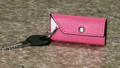 Pink Leather TagWrap with Royal Blue Trim.  $8.99. Organize all your plastic keytags, loyalty cards, and store ID tags.  www.tagwrap.com