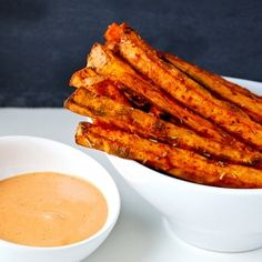 Spiced sweet potato oven fries with chipotle-garlic dipping sauce.