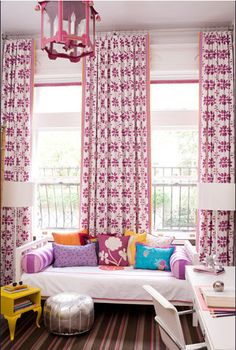 Sophisticated girl's bedroom, raspberry drapes and lantern