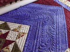 Star Sampler, quilted by Susan Lawson. Great way to break up a wide border with quiliting.
