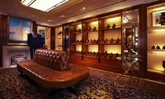 Recalling British gentlemen's clubs and the art-deco sensibility of the Ralph Lauren London 1 New Bond Street store, the interior evokes a masculine ambiance created with mahogany millwork, stained ebonized and French polished, and leather and limestone accents