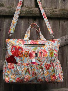 clever tote pattern boasts over 40 pockets of varying sizes to hold all of your tools and notions and a roomy interior to organize and carry any project. Detailed step by step directions and clear diagrams make for a smooth assembly. Included are instructions for creating two different types of zippers and three different types of pockets as well as attaching various types of hardware such as snap hooks, D-rings and purse feet..