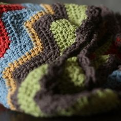Modern colors make this crochet blanket perfect for the little one in your life. The pattern is easy and free!