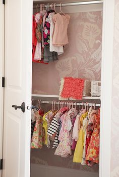 We love the idea of putting wallpaper in the closet. #nurserydesign