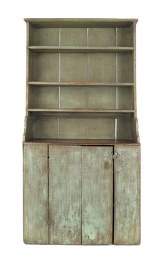 "New England painted pine two-part pewter cupboard, early 19th c., retaining a blue/green surface, 73 1/4"" h., 37"" w."