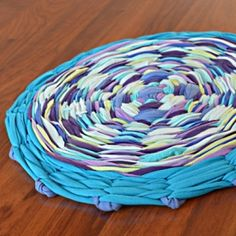 Upcycle a hula hoop and some old T-shirts into a hula hoop rag rug that's pretty and practical!