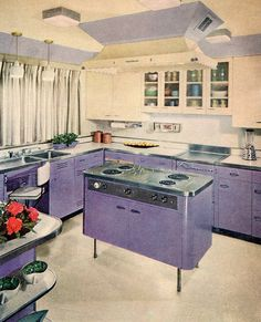 It's really (really!) not every day one encounters a lavender hued vintage kitchen like this sleek, inviting beauty. #purple #home #decor #vintage #retro #1950s #kitchen