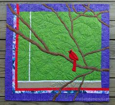 This spring I got a stalker.  He watched me almost every time I left or came home. One day I was lucky and I was able to shoot a great pic of him through my window. He's gone now and I miss him. Here is the quilt I made out of his picture.     By the way, my students in next Saturday's Free Motion Quilting class are going to be the first ones to see this quilt in person and learn how to quilt leaves plus many other motifs.    QUILTS BY MARISELA original design.