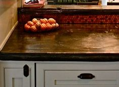 """Got Pennies? Kitchen backsplash made of copper pennies .. foreign coins  (from your travels) would be an interesting conversation piece.  Use mesh backing for mosaic tiles that has glue that could hold metal (or use penny tile jugs http://themadeshop.goodsie.com/copper-penny-tile-jig).  FYI:  it takes about 3,889 pennies for a 3'-8"""" x 5'-8"""""""