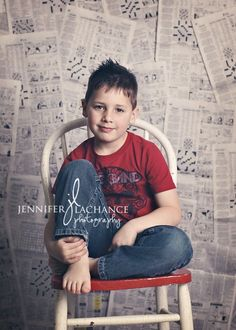 newspaper backdrop; I'm pinning this as an example of what I *don't* like.  What does newsprint have to do with this little boy?  The backdrop should add to the picture, not be a distraction.