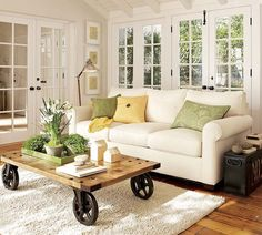 I really like the white, green and yellow together. Like the coffee table but would prefer legs instead of wheels :)