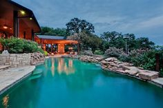 Pool treatment at home in Arlington, TX.  Nice use of rocks for borders.
