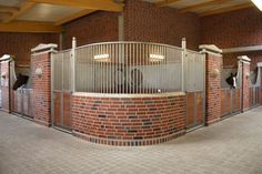 Oh. My. Goodness. This is fabulous. Love the brick work, the half-pillars, and most of all, the rounded corner stall with TWO doors! Also, there are two small round windows in the corner in the back. Very interesting!