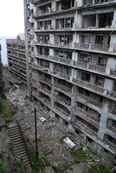 Hashima Island, Japan. A tiny island where the sole occupation was coal mining. The mines were closed and the island abandoned in 1974.