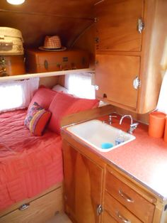 Photo of double bed in 1956 Shasta 14 foot travel trailer