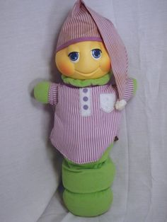 glow worm with purple sleeping shirt and night cap