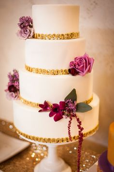 Gold and orchid colored cake details!