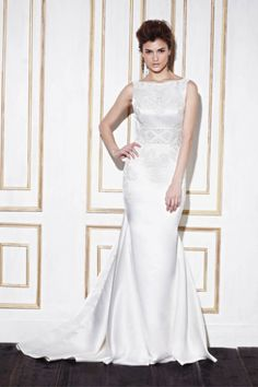Silk Enzoani wedding dress: http://www.stylemepretty.com/2014/10/29/12-high-neckline-dresses-that-are-absolutely-stunning/