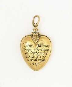 """Gold locket with black enamel, English, ca. 1597. Engraved: """"John Monson born.the.tenth of September at.12. of the clok. at night 1597"""" John was born with a piece of the caul (the membrane that contains the foetus) covering his head. According to family tradition, this locket contains part of the caul. This was considered to be lucky, especially as a protection against drowning. There was a strong belief in the medicinal or magical properties of various natural substances in Renaissance Engla..."""