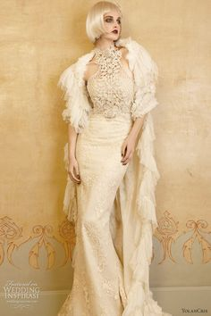 Valance gown in Chantilly lace, featuring crocheted halter neck bodice adorned with guipure appliques.