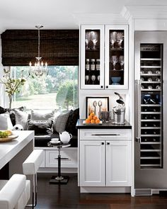 wine fridge, coffee bar, and banquette
