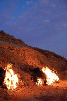 """Yanar Dag or """"Fire Mountain"""" is one of Baku's can't-miss natural wonders -  a natural gas fire that blazes continuously on a hillside on the Caspian Sea."""