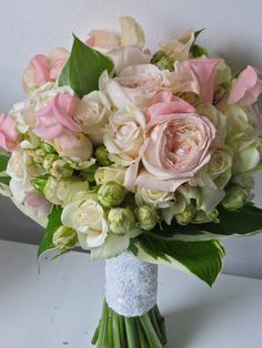 Garden Roses, Tulips and Sweetpeas in a Blush Pink Spring Bridal Bouquet.  Flowers of Charlotte loves this! Find us at www.charlotteweddingflorist.com