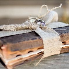 Find an old Bible or book on love and wrap it with a ribbon, this is a great option for a ring bearer pillow.