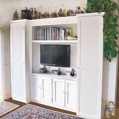 Want the look of a custom built-in without having to shell out big bucks? This one was put together with inexpensive IKEA Pax wardrobes and lumber rescued from construction sites for just $320. | thisoldhouse.com