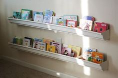 Our rain gutter bookshelves. Some info on how we made them and how we use them.