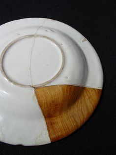 The reverse of Delftware plate, repaired. Wabi sabi